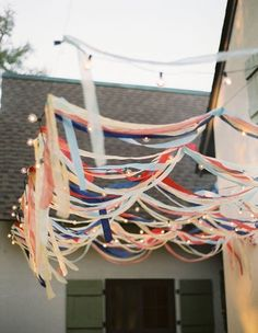 Lights + streamers for the perfect backyard birthday party.