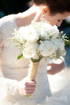 cream peony bouquet wrapped in gold and cream striped silk