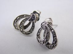 "Designer- Avon Size- 1/2 inch in length Hallmark- Stamped ""Avon"" on earring findings Features- Silver tone double hoop Overall Condition- Very good to Excellent  Item Notes- No plating loss"