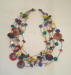 Button necklace multi strings - not quite so colorful, though... I did mine in neutrals. It tangles easily. But i love it!