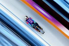 Valentin Cretu of Romania takes part in a men's luge training session ahead of the Sochi 2014 Winter Olympics at the Sanki Sliding Center on...