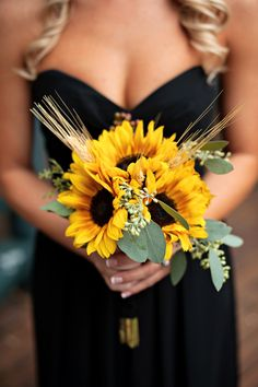If dark brides maids dresses, and the wedding is in fall, have them hold sunflowers