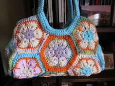 Bag Lady Pinspiration. Portfolio al crochet flowers African!.  ☀CQ #crochet #bags #totes  http://www.pinterest.com/CoronaQueen/crochet-bags-totes-purses-cases-etc-corona/