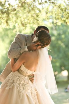 I like how this gives a different angle of the couple in this post, showing if the back of the dress and hair.