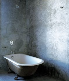 article-image Roll top bath against wall.