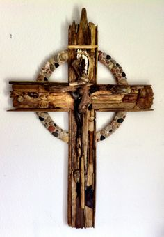cross created from stones and driftwood parishioners found over the summer    http://www.covchurchcheboygan.com/driftwood-cross-art-project/