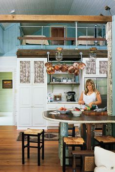 Reclaimed Country - Our Best Cottage Kitchens - Southernliving. The homeowners mixed old and new materials, decorating with found objects, like the shrimpers' rope that accents the edge of their countertop.    Tour the rest of this Alabama country cottage
