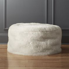 Shop faux fur pouf. Relaxed and oversized, our lounge-worthy round gets maxed out in soft white faux fur. Adds warmth and a little glam to any space. Better yet? Dense bead filling is substantial enough for seat/ottoman/tray duty.