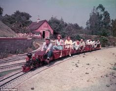 Disney Train Ride: American producer, director, and animator Walt Disney - drives a miniature railroad with a line of passengers behind him at his home, (Photo by Gene Lester/Archive Photos/Getty Images) Old Disney, Disney Home, Disney Fun, Disney Magic, Disney Parks, Disney Movies, Walt Disney World, Disney Pixar, Punk Disney