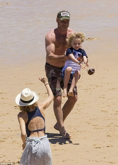 Nearly: Naomi also got involved and threw a ball, with Liev giving their sons a helping ha...