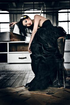 Lara Jade - black gown on chair - I love the industrial warehouse setting with the gown.