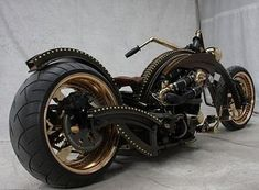 steampunk Harley Davidson. The bike frame looks like a Steampunk skeletal structure more than a frame. There's also a cool T-Sable Spring engine and of course a Harley-Davidson transmission.
