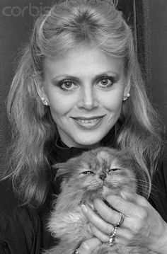 Britt Ekland with a happy cat. actress .... Bond Girl in the Man with the Golden Gun and others