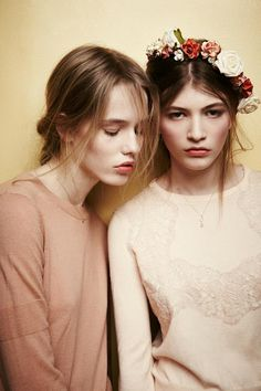 Two model pose, with floral crown.