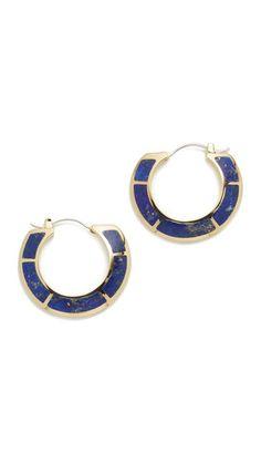 Lapis detailing trims these Pamela Love hoop earrings. Hinged post closure.