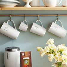 Love the way the mugs are hung up. Love the wall color too.