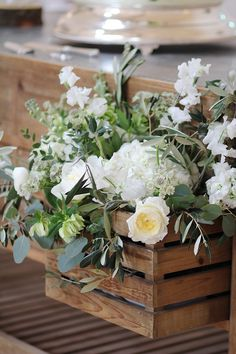 Sideboard draw floral styling | Mediterranean style wedding flowers at Millbridge Court located in Frensham, Surrey. Created by Hannah Berry Flowers hannahberryflowers.co.uk