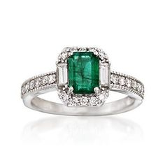A stunning 1.00 carat emerald-cut emerald steals the spotlight in this splendid ring design, joined by .45 ct. t.w. round and baguette diamonds shimmering along the polished 14kt white gold band, complete with milgrain detailing. Diamond and emerald ring. Free shipping & easy 30-day returns. Fabulous jewelry. Great prices. Since 1952.