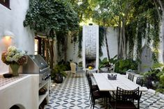 love the tiled floor - in fact - love everything about this garden area!