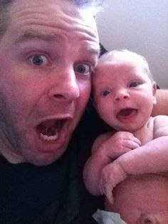 Cuteness to the max. Dad taking selfies with newborn.