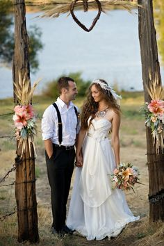 Rustic feminine south western take on a wedding arbor with old west feel
