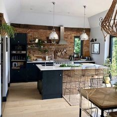 11 Kitchen Backsplashes to Wow Your Guests - dark kitchen with exposed brick wall of Sharon Hornsby Style Farmhouse Style Kitchen, Modern Farmhouse Kitchens, Home Decor Kitchen, Interior Design Kitchen, Kitchen Ideas, Rustic Kitchen, Industrial Kitchens, Contemporary Kitchens, Kitchen Designs