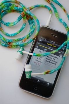 headphone cozies? not quite sure how to make, but it seems like you just cast on to the wire and treat it as part of the crochet/knit yarn...