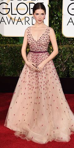 Anna Kendrick channeled her Cinderella character and opted for a princess moment as well. The Into The Woods actress went with a blush tulle Monique Lhuiller gown.