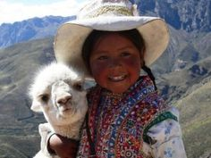 Peruvian little girl and her pet friend in the Andes
