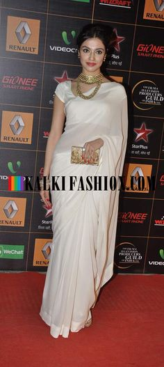 http://www.kalkifashion.com/ Divya Khosla Kumar chooses a simple and sober look in Nachiket Barve saree to attend Star Guild Awards 2014