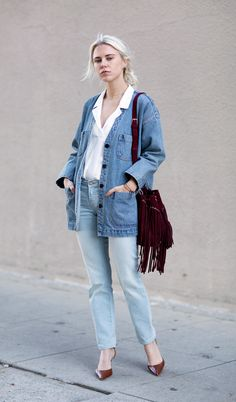 Denim blazer with jeans and a red suede fringe bag.