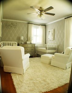 Love those lanterns over the crib & the stenciled walls. So many pretty details here.