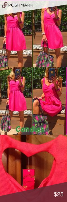 """🍭🍬 I Want Candie's!!🍬🍭 NWT Looking for a """"sweet"""" little dress? Look no further! This NWT sleeveless Candie's Floral Crush Red, which reads as coral/pink, has a sweetheart neckline. A narrow band separates the bodice from the skirt, which is flared and lightly gathered at the top. Fabric has corded appearance. Upper back cut out in the shape of a ❤ 7 1/2 x 8 1/2""""️. 98%poly, 2%spandex. Lining 100% poly. L33"""" P-P 18"""" stretched. Shoulder to skirt 15 1/2"""". Feed that sweet tooth!Get your candy…"""