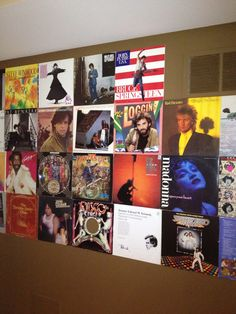 Music records decorate a long wall in man cave -- put up with command strips. Parede omi