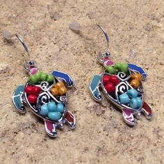 Colorful Sea Turtle Design / Earrings Details:	1 Inch X 3/4 Inch Sea Turtle Design | Metal / Bead / Epoxy | Fish Hook | Lead & Nickel Safe | Gift  Packaging Jewelry Earrings