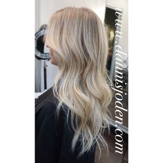 Natural root melting into platinum blonde Balayage. Hair by Danni in Denver CO