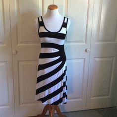 Calvin Klein Dress SUPER SOFT!!! Stretchy black and white striped dress. Very flattering and flowy. Only worn once! Calvin Klein Dresses