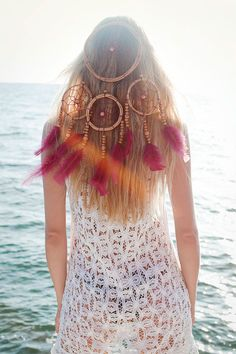 Hmmm... I never thought about wearing a dream catcher in my hair. I just may have to try that!