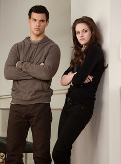 Taylor Lautner and Kristen Stewart as Jacob Black and Bella Swan