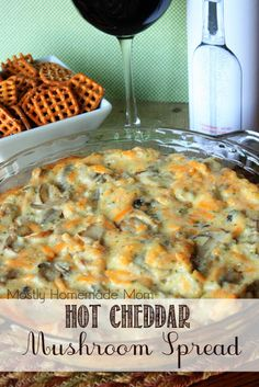 Hot Cheddar Mushroom Spread - Mushrooms, ranch dressing, mayo, cheddar, and parmesan bake together in this addictive appetizer - perfect for salty pretzels!