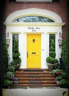 Bright front door, house numbers spelled  out.