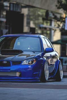 Boosted Blue STi The hawk eye is my fav but this girl is damn sexy Can't get enough #JDM and #Import Style? Neither can we! Join our board to share your pics! Contact us at #Rvinyl.com!