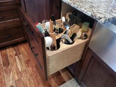 Built-in utensil receptacles in a pullout drawer!! If I could have one specialized cabinetry insert, I think this would be it.