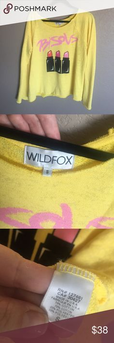 """WILDFOX  Bisous Oversized Sweatshirt Jumper S This is an oversized Wildfox sweatshirt in good condition. There are no stains or tears but there is a little piling. It has raw edges and is incredibly snugly! 22"""" across underarms 25"""" long. Wildfox Tops Sweatshirts & Hoodies"""