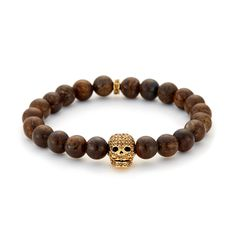 Introducing our NEW Bronzite/Gold & Brown Crystal Skull Bracelet. The warm tones of the semi-precious bronzite stones blend well with the gold skull giving this bracelet a superb finish.  Beautifully contrasted by our handcrafted gold loop & skull design and set with precision cut chocolate toned brown Swarovski crystals, it's a stylish accessory for any look. | Available now at Northskull.com [Worldwide Shipping] #Luxury #Jewelry #Northskull