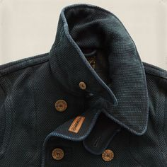 Limited-edition coat with details inspired by vintage Japanese firemen's jackets. Made from indigo-dyed basket-woven cotton that emulates the cloth used for traditional kendo uniforms. Finished with star-and-anchor-engraved genuine horn buttons