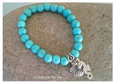 Check out this item in my Etsy shop https://www.etsy.com/uk/listing/243527836/turquoise-beaded-bracelet-with-silver