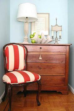 Red and white stripe chair, aqua walls.
