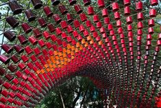 rojkind arquitectos: portal of awareness.  a curtain of coffee mugs on a city street.