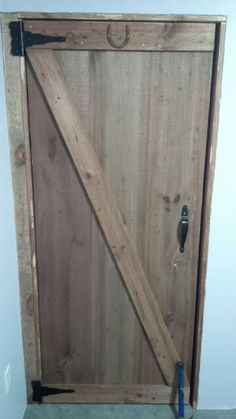 Homemade barn door fabricated with distressed rough cut pine and homemade steel wool and vinegar stain. Steel Wool And Vinegar, Vinegar Stain, Homemade Closet, Fiber Cement Siding, Remodeling Costs, Barn Door Closet, Man Crafts, Building A New Home